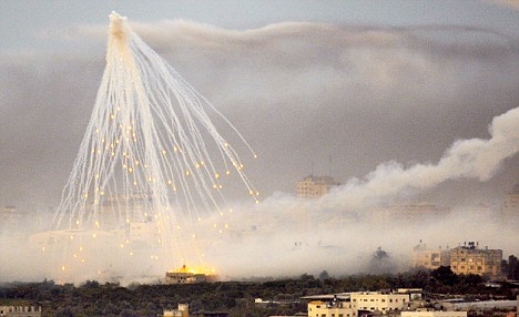 A shell fired by Israeli forces explodes over the northern Gaza